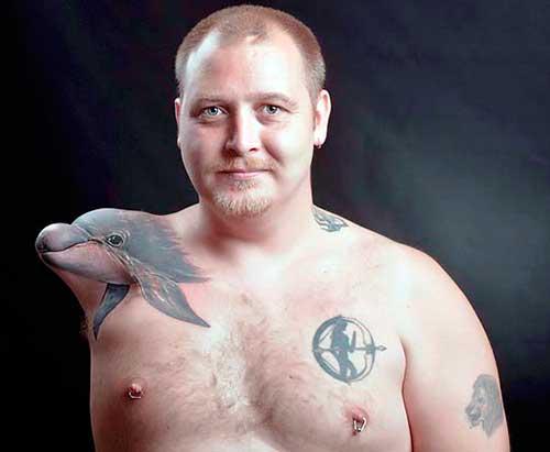 Tierra de delfines Tatuaje 12 500x541